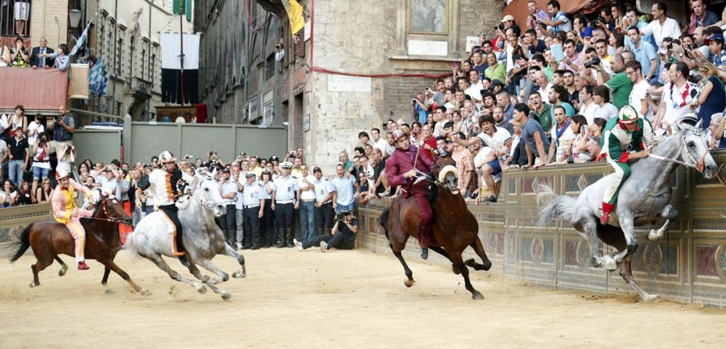 Jockey Giovanni Atzeni of the Oca parish leads the Palio race in Siena